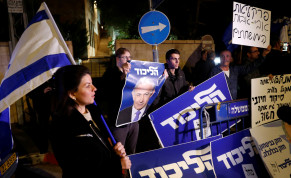 Supporters of Israeli Prime Minister Benjamin Netanyahu protest outside his residence following Israel's Attorney General Avichai Mandelblit's indictment ruling in Jerusalem