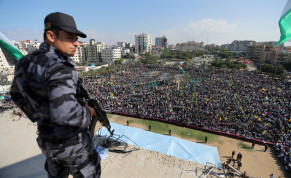 A member of security forces loyal to Hamas stands guard as supporters of former senior Fatah official Mohammad Dahlan take part in a rally marking the death anniversary of late Palestinian leader Yasser Arafat, in Gaza City November 9, 2017