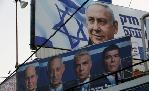 A Likud party election campaign billboard depicting Israeli Prime Minister Benjamin Netanyahu is seen above a billboard depicting Benny Gantz, leader of Blue and White party, in Petah Tikva, Israel