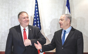 MMUNITY? WHO, ME? Prime Minister Benjamin Netanyahu makes a point on Wednesday to US Secretary of State Mike Pompeo in Lisbon