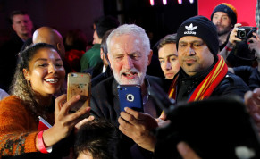 Britain's opposition Labour Party leader Jeremy Corbyn poses for photos with supporters during a general election campaign rally in Birmingham, Britain December 5, 2019