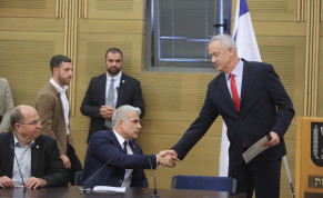 Blue and White leader Benny Gantz shakes hands with Blue and White MK Yair Lapid