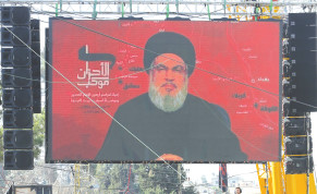 EBANON'S HEZBOLLAH leader Sayyed Hassan Nasrallah addresses his supporters through a televised speech in Baalbeck, Lebanon, last year.