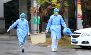 FILE PHOTO - Medical staff carry a box as they walk at the Jinyintan hospital, where the patients with pneumonia caused by the new strain of coronavirus are being treated, in Wuhan, Hubei province, China January 10, 2020. Picture taken January 10, 2020