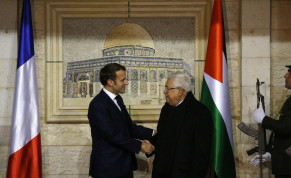 Palestinian President Mahmoud welcomes French President Emmanuel Macron at his headquarters in Ramallah in the West Bank, January 22, 2020