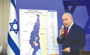 PRIME MINISTER Benjamin Netanyahu points to a map of the Jordan Valley