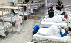 Medical workers in protective suits attend to patients at the Wuhan International Conference and Exhibition Center, which has been converted into a makeshift hospital to receive patients with mild symptoms caused by the novel coronavirus, in Wuhan, Hubei province, China February 5, 2020
