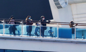 Passengers and children stand on the desk of the cruise ship Diamond Princess, as the vessel's passengers continue to be tested for coronavirus, at Daikoku Pier Cruise Terminal in Yokohama, south of Tokyo, Japan February 13, 2020