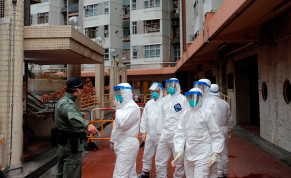 Police in protective gear wait to evacuate residents from a public housing building, following the outbreak of the novel coronavirus, in Hong Kong, China February 11, 2020
