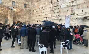 Dozens gathered at the Western Wall on February 16, 2020 to pray for those affected by the coronavirus outbreak.