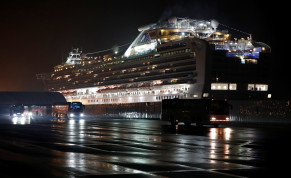 Buses believed to carry the U.S. passengers of the cruise ship Diamond Princess, where dozens of passengers were tested positive for coronavirus, leave at Daikoku Pier Cruise Terminal in Yokohama, south of Tokyo