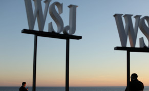 A security member keeps watch as attendees arrive at the Wall Street Journal Digital conference in Laguna Beach