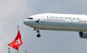 A Cathay Pacific Boeing 777-300ER plane lands at Hong Kong airport in Hong Kong, China August 14, 2019.