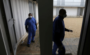 Palestinian health workers wearing protective masks walk in a quarantine zone installed by the ministry of health to test passengers returning from China for coronavirus, at Rafah border crossing in the southern Gaza Strip February 16, 2020.