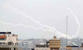 Trails of smoke are seen as rockets are fired towards Israel, in Gaza