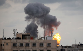 Flame and smoke are seen during an Israeli air strike in the southern Gaza Strip
