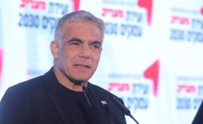 Blue and White MK Yair Lapid is seen at the 'Maariv' Conference.