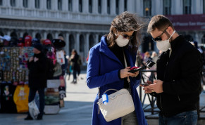 Tourists wear protective masks in Saint Mark's Square in Venice as Italy battles a coronavirus outbreak, Venice, Italy, February 27, 2020
