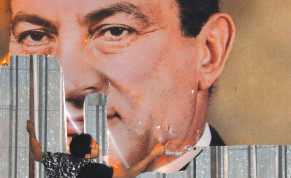 AN ANTI-GOVERNMENT protester defaces a picture of then-Egyptian president Hosni Mubarak in Alexandria, in 2011.