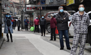 Residents line up to collect vegetables purchased through group orders at a residential area in Wuhan, the epicentre of the novel coronavirus outbreak, Hubei province, China March 5, 2020.