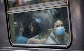 A woman wears a face mask on the subway as the coronavirus outbreak continued in Manhattan, New York City, New York, U.S., March 13, 2020