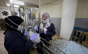 Palestinian women work in a sanitiser factory amid precautions against the coronavirus, in Hebron in the West Bank March 12, 2020