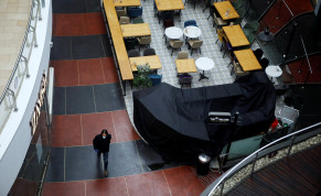 A man wearing a mask walks inside a shopping centre after Israeli Prime Minister Benjamin Netanyahu's government announced that malls, hotels, restaurants and theaters will shut down from Sunday, in an escalation of precautionary measures against coronavirus, in Tel Aviv, Israel March 15, 2020