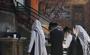 Hasidic Jewish men gather for a morning prayer outside of a synagogue, closed due to coronavirus disease (COVID-19), in South Williamsburg, Brooklyn, New York City, New York
