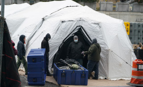 Workers construct what is believed to be a makeshift morgue behind a hospital during the outbreak of coronavirus disease in New York City