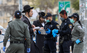 Police officers close synagogues and disperse public gatherings in an ultra orthodox Jewish neighborhood in Beit Shemesh, following the government's decisions, in an effort to contain the spread of the coronavirus on March 31, 2020