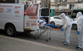 Israeli Magen David Adom medical team members transfer an Israeli man, suspected of being Covid-19 positive, in the Ultra-Orthodox Jewish city of Bnei Brak, March 31, 2020.