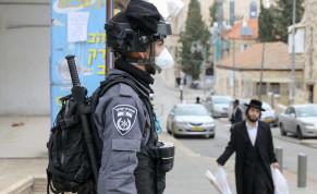 Border Police go about coronavirus inspections in Mea Shearim, a haredi neighborhood in Jerusalem.