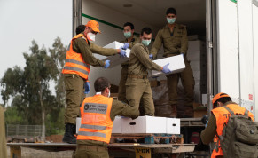 Soldiers of Israel's Home Front Command deliver food parcels to Bnei Brak, currently under coronavirus lockdown, April 5, 2020