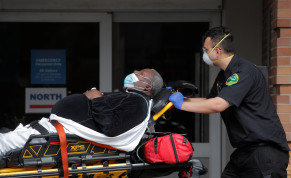 Paramedics take a patient into emergency center at Maimonides Medical Center during the outbreak of the coronavirus disease (COVID-19) in the Brooklyn borough of New York City, New York, U.S., April 7, 2020