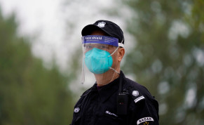 Security guard wearing face mask and face shield is seen in Wuhan