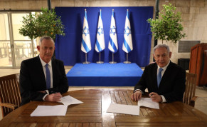 Prime Minister Benjamin Netanyahu and Blue and White leader Benny Gantz sign a unity government agreement