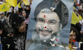 A HEZBOLLAH supporter beams at a poster of Hezbollah leader Hassan Nasrallah during a rally on the anniversary of the Israeli withdrawal, on May 25, 2009