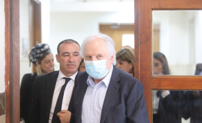 SHAUL ELOVITCH appears in Jerusalem District Court Sunday at the start of their trial.