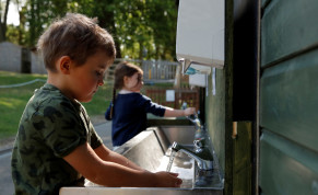 FILE PHOTO: Children are seen washing their hands at Heath Mount School as some schools reopen, following the outbreak of the coronavirus disease (COVID-19), Watton-at-Stone, Britain, June 2, 2020.