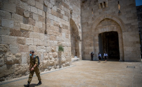 An Israeli soldier wearing a face mask walking in Jaffa Gate, outside Jerusalem Old City on July 5, 2020.