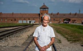 Holocaust Survivor Edward Mosberg outside Birkenau.