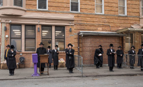 Hasidic men pray outside at a socially distanced service in the Borough Park neighborhood of Brooklyn, March 30, 2020.