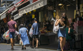 Israelis, wearing face masks for fear of the coronavirus, shop for grocery at the Mahane Yehuda market in Jerusalem on July 14, 2020. Israel has seen a spike of new COVID-19 cases bringing the authorities to reimpose restrictions to halt the spread of the virus