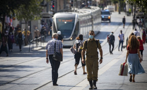 Jerusalemites wearing face masks for fear of coronavirus  walk on Jaffa road in the City Center of Jerusalem on July 12, 2020. Israel has seen a spike of new COVID-19 cases,  cabinet ministers imposed new restrictions on public gatherings in a bid to stem the rising infection rate of the coronavirus