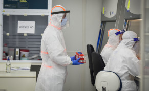 Israeli army Technicians carry out a diagnostic test for coronavirus in a IDF lab in central Israel on July 15, 2020.