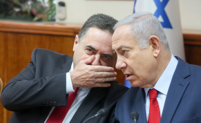 Israel Katz chats with Prime Minister Benjamin Netanyahu at a cabinet meeting