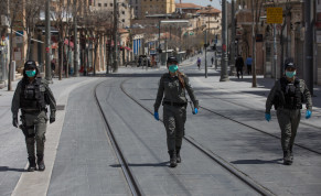 BORDER POLICE patrol a nearly empty city center during a partial lockdown in early April