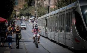 People wearing face masks walk on Jaffa Street in downtown Jerusalem, August 2, 2020