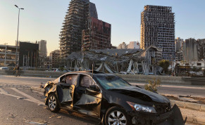 Damaged vehicle and buildings are pictured near the site of Tuesday's blast in Beirut's port area