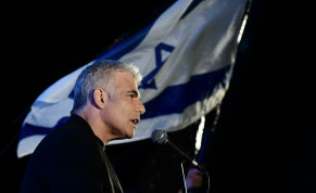 MK Yair Lapid speaks during a protest against Prime Minister Benjamin Netanyahu calling on him to quit, at Rabin Square in Tel Aviv on April 19, 2020